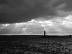 Hope (The sixt day) Tags: sea bw lighthouse water hope warnemnde sad friendship sunrays blackdiamond blackwhitephotos justclouds