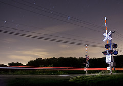 crossing ( estatik ) Tags: county railroad car night train dark lights star crossing pennsylvania space country trails rr visit pa wires getty intersection streaks buckingham bucks overhead xing lahaska streetroad semiphore