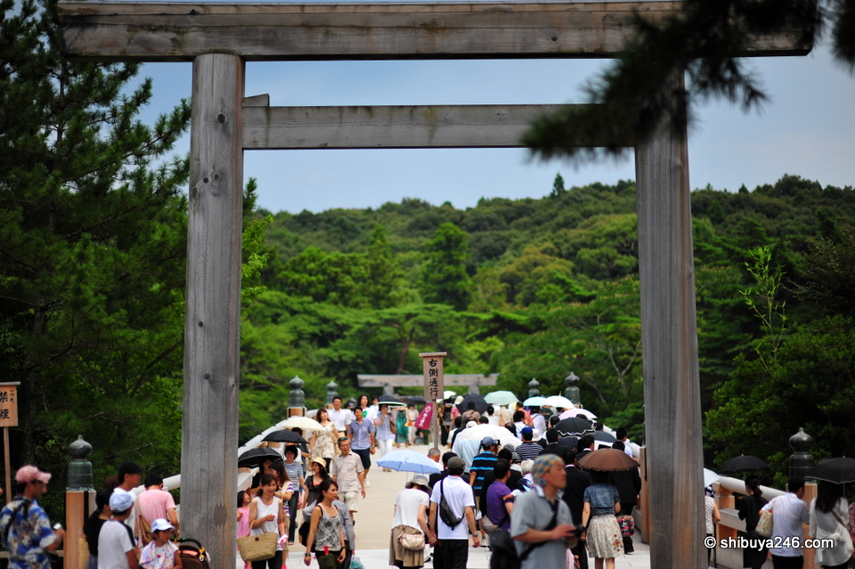 The entrance to Ise Jingu Naiku leads over a wooden bridge with beautiful mountain views