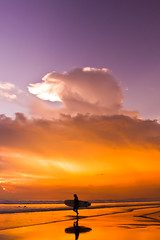 Surfing the sunset (Filip Musial Photography) Tags: travel sunset bali clouds indonesia island photography surfer surfing kuta