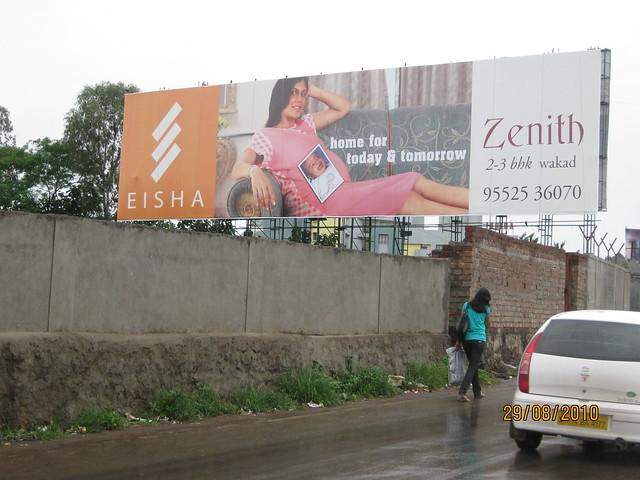 Hoarding of Eisha Zenith on the service road to Elite Homes, Mumbai Pune Expressway, Wakad Pune