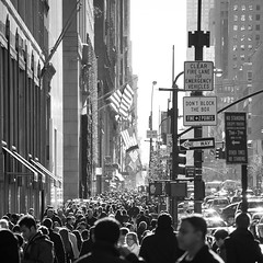5th avenue mob. (Vitaliy P.) Tags: street new york city nyc light red people sun white signs black cars monochrome sign reflections hair way square photography one nikon glow traffic manhattan candid crowd flags tourists midtown american rush hour crop heads strong gothamist rim avenue 5th fifth newyorkers 55200mm d80 vitaliyp