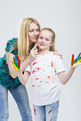 Family Ideas. Mother and Her LIttle Caucasian Blond Daughter Having Hand and Face Paint Time Together Indoors. (DmitryMorgan) Tags: 2 3035 711years active againstwhite artist artistic arty caucasian cheerful child childhood color colorful colour concept craft creative creativity daughter drawing education female fingers fun gouache hand happy kid little messy middleaged mom multicolor paint painter palms parent people playful pleasure positive preschooler smiling tshirt two woman young