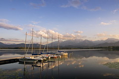 Mountain Lake Idyll (parkerbernd) Tags: mountain lake summer evening idyll sailing jolly boats ship club small harbour jetty alps alpine foreland region sunset clouds reflection fantastic light hopfen hopfensee allgäu bavaria germany