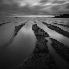 Sand Bay (Adam Clutterbuck) Tags: ocean uk greatbritain sea england blackandwhite bw monochrome square mono bay blackwhite sand mud unitedkingdom britain tide somerset bn severn gb bandw sq channels steep holm greengage adamclutterbuck sqbw bwsq showinrecentset sandpointelements