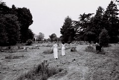 Ghosts (Adele M. Reed) Tags: trees girls blackandwhite film graveyard contrast 35mm shoot grain ghosts coventry ghostly commission figures sparse redemption forgiveness canoneos500n illford400 laurensheerman