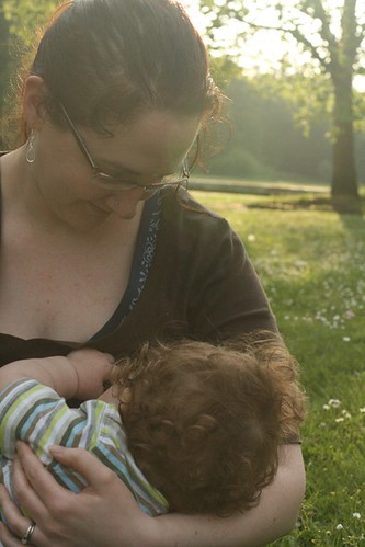 breastfeeding on the grass 11 months