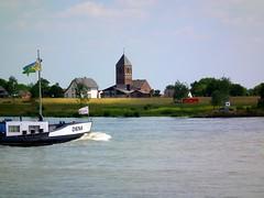 Diena coming along (xmyrxn) Tags: church river ship kirche fluss rhine rhein schiff mv diena emmerich dornick xmyrxn