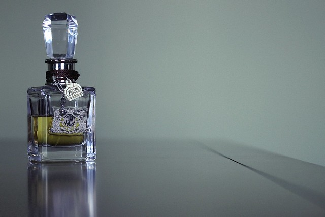 stilllife table bedroom perfume dof grainy juicycouture soe tone filmgrain 1on1bokehdofphotooftheweek 1on1bokehdofphotooftheweekjuly2010
