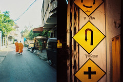 Monk / Street Signs Half-Frame (John Ryan Brubaker) Tags: thailand xpro crossprocess diana chiangmai halfframe provia dianamini urbansacred