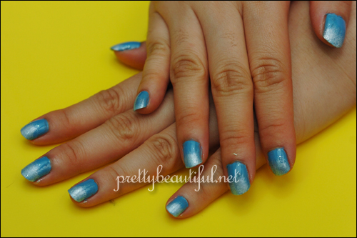 completed blue sky sponge nail art
