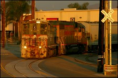 Sunset Street Running (greenthumb_38) Tags: california street railroad sunset 2004 train canon300d sp marlboro crossbuck locomotive canondigitalrebel orangecounty anaheim goldenhour crud switcher southernpacific espee streetrunning unpatched mp15ac yardgoat jeffreybass loa31