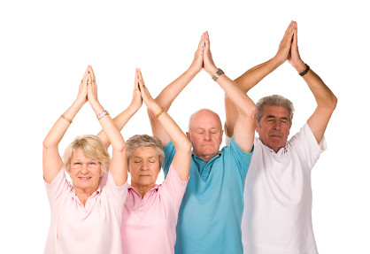 Group of mature people doing yoga