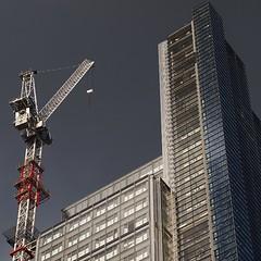 up (Cosimo Matteini) Tags: sky building london architecture skyscraper pen 50mm crane olympus f18 contruction zuiko liverpoolstreet bishopsgate epl1 cosimomatteini