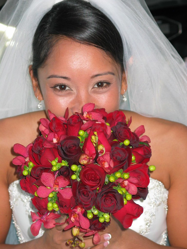 Red Bridal Bouquet with red roses with green berries and orchids
