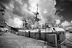 _CF_3004-web (Carlos Flix) Tags: urban bw costa water dark coast boat fishing felix carlos bn nubes flix viejo menorca mahn ma illa pesquero carlosfelix paisatgeurb
