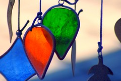 Through the Glass (Mcmommie -) Tags: blue summer orange green glass sony stained windchimes mcmommie alphapicnik