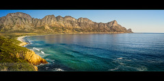 Road to RooiEls.. (Chantal Steyn) Tags: ocean road travel blue sea mountain reflection green tourism beach water rock landscape southafrica photography coast town nikon aqua waves view panoramic vegetation polarizer westerncape coastalroad d300 rooiels turqois nohdr 1685mm chantalsteyn