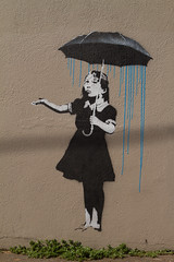 Umbrella Girl know's Portland (Squid Vicious) Tags: oregon portland graffiti banksy umbrellagirl se12thstark