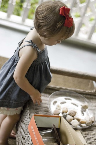 playing with rocks on the front porch.  her favorite thing to do in the world