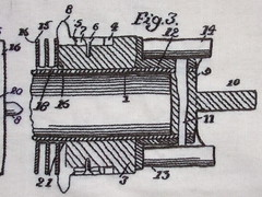 A detail from an embroidery of an old blueprint patent drawing for a Jacquard loom part.
