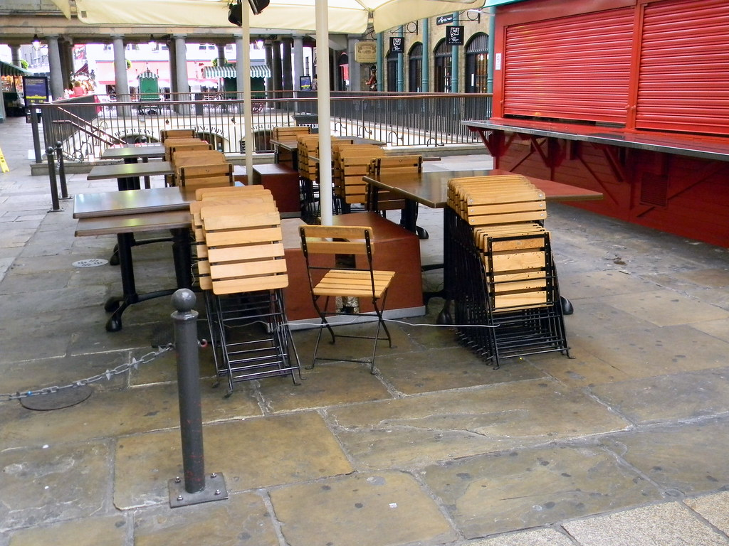 folded chairs tables covent Garden london 21st August 2010 9:07.06am