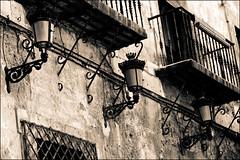 107 (Corrosif) Tags: texture textura wall sepia pared monocromo farola streetlight streetlamp balcony wroughtiron diagonal forge balcn relieve monocrome forja hierroforjado