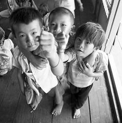 cambodia kids, tonle sap lake (Demis de Haan) Tags: travel school lake kids temple ruins asia cambodia southeastasia khmer angkorwat siem reap siemreap angkor sap bayon tonle flickraward flickraward5