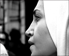 `349 (roll the dice) Tags: life street uk portrait people urban blackandwhite blur london art classic girl westminster face scarf nose photography eyes pretty close natural image zoom candid muslim islam streetphotography stranger collection arab unknown wisdom westend unaware londonist
