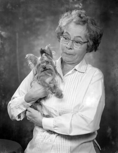 Portrait of Katherine McCrow with a Yorkie dog: Tallahassee, Florida