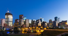 Calgary Skyline at Night (Jim Boud) Tags: longexposure travel blue sky canada reflection green calgary skyline architecture night skyscraper canon dark lens landscape eos lights hotel evening shiny cityscape apartment nightshot crane dusk wideangle canadian alberta northamerica layers usm dslr digitalrebel photoart efs 1022mm digitalslr province artisticphotography superwideangle 10mm canonefs1022mmf3545usm 22mm 550d jimboud t2i jamesboud eos550d kissx4