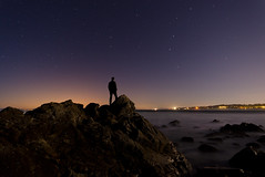 Pebble Beach at Night (andreaskoeberl) Tags: ocean california longexposure sea sky usa beach silhouette night dark stars iso800 lights us lowlight nikon rocks unitedstates pebblebeach 30s highiso 30seconds starrynight flickrchallengegroup flickrchallengewinner d7000 nikond7000 andreaskoeberl