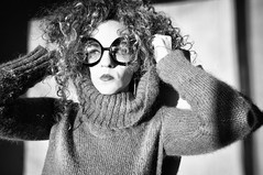 Week 4 of 52 [ free spirit ] (DaizyB) Tags: light sunset blackandwhite bw woman sun selfportrait wool window self hair glasses daylight sweater big crazy nikon expression sigma curls wideangle attitude curly huge 1020mm attention d300 hugeglasses freespirit extravagant