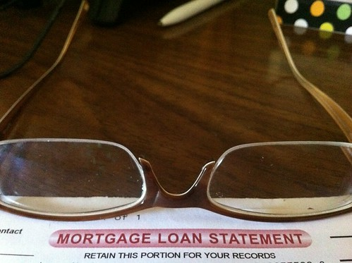 glasses resting on mortgage application