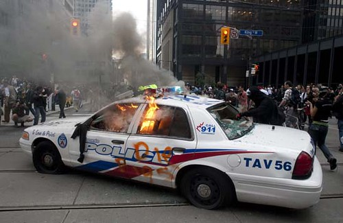 A police car burns after G20 summit protesters set fire to it in downtown Toronto on Saturday, June 26, 2010. THE CANADIAN PRESS/Chris Young by Pan-African News Wire File Photos