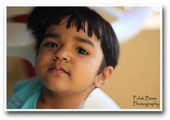 Sweet, Innocent yet Naughty (pulak_bose) Tags: portrait india smile closeup canon naughty children eos rebel 50mm kid soft child sweet bokeh bangalore innocence pondicherry 500d mywinners t1i