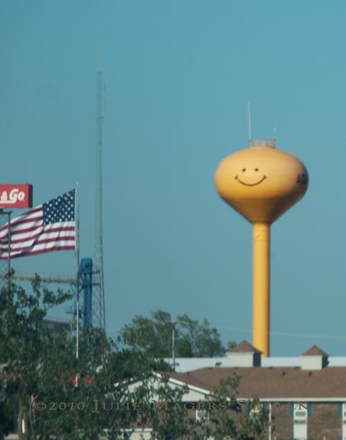 Happy face on yellow water tower