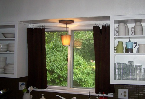 newly hung kitchen curtains by you.
