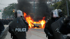Riot Police With Car Fire (pascalmarch) Tags: seattle black canon spectacular fire crazy high team pittsburgh chaos cops cross guitar quality explosion police super rubber player des gas ring cash burning un 7d johnny summit block hd bullet rcmp tear squad 18 tamron harper riots protests rt protesters swat politic g8 anarchists violent spvm 270 1080 g7 sommet clashes 720 tactic emeute 550d ameriques t2i