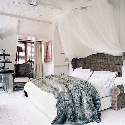 bedroom with fur+wicker bed