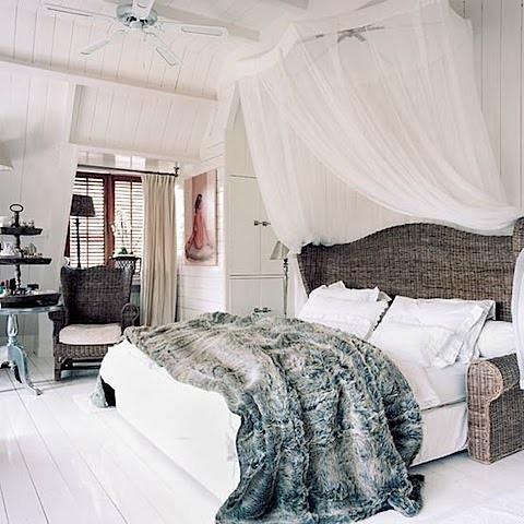 bedroom with fur+wicker bed