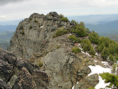 An extended ridge with the marked summit as the far highpoint.