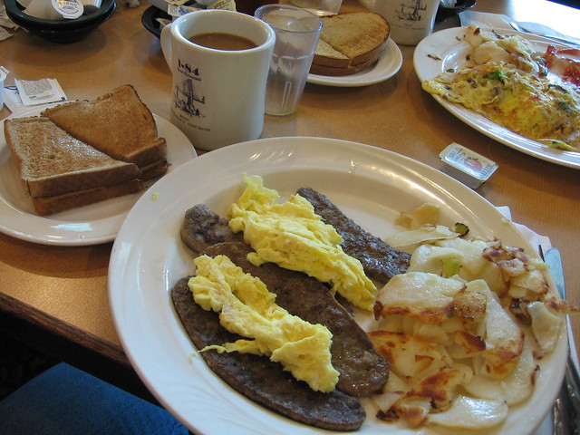 Scrambled eggs, hash browns, and gyro meat