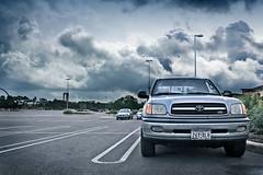Ominous Parking Lot (streubie) Tags: clouds photoshop truck parkinglot ominous dramatic wideangle sixflags