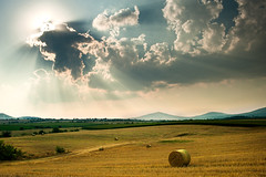 Summer sun [explored] (Nick-K (Nikos Koutoulas)) Tags: light sunset summer sun nature field clouds greek nikon ray balls nikos greece hay f28 nickk  ellada 3570mm    kozani    d700        koutoulas