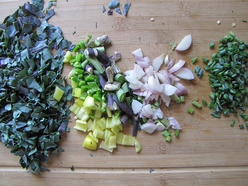 chopped kale, peppers and shallot bulbs and tops