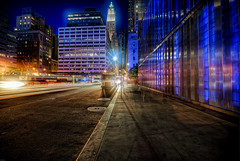 the woolworth blues (mudpig) Tags: newyorkcity longexposure light newyork reflection night skyscraper geotagged cityscape traffic manhattan worldtradecenter 7 woolworth wtc hdr traffictrails lighttrail goldmansachs wtc7 mudpig stevekelley