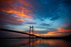 Sunset @ 2nd Hoogly Bridge   Kolkata (@k@sh) Tags: bridge sunset man colors canon landscape 350d boat wide sigma front 2nd explore page frontpage 1020 kolkata ghat hoogly akash xplore princep