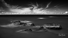 thirty ([Adam Baker]) Tags: summer bw lake ny ontario beach nature water monochrome clouds photoshop canon landscape rocks long exposure surf windy upstate greatlakes shore portfolio wisp cpl 1740l neutraldensity adambaker ndx400 5dmarkii mexicopointstatepark