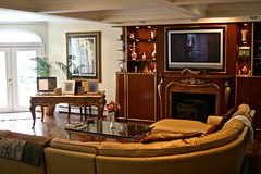 "60"" plasma, in-ceiling surround system, equipment in cabinet & custom remote"